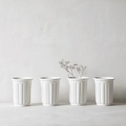quatre-timbale-en-porcelaine